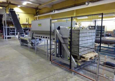 Feedingline with boxturner, inspection and feeding to evenflow hopper before Newtec weigher.